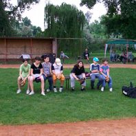 Kids wait their turn for an at-bat Saturday in Belgrade